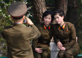Two young members of the Korean Peoples Army pose for a photo near the site of former North Korean leader Kim Il-Sung's house in Pyongyang