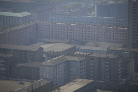A thick haze covers a series of apartments blocks in central Pyongyang