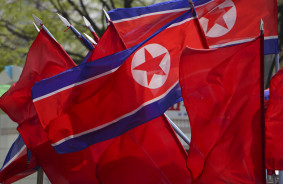 North Korean flags fly on the streets on Pyongyang