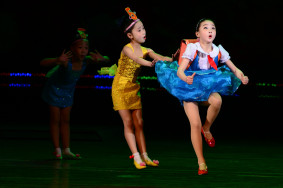 Young performers perform a dance during a presentation at the Pyongyang Children's Palace