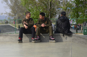 Two boys chat at the Pyongyang skate park
