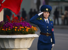 A traffic lady salutes while on duty in Pyongyang