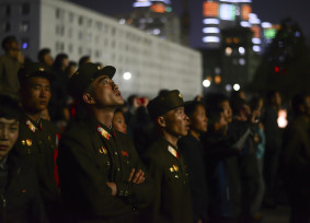 "Korean Peoples Army soldiers gaze up in awe at the fireworks to celebrate ""The Day of the Sun"" holiday in Pyongyang."