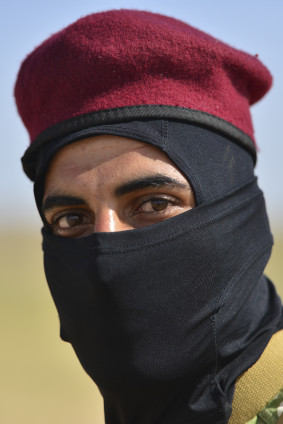 An Iraqi militia poses for a photo at a secret camp outside of the ISIS held city of Mosul on May 11, 2015. The soldiers are all former residences that fled their home and are now preparing to retake their city. Many of the soldiers did not want their faces shown as they still have families trapped in Mosul. Gavin John