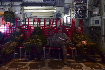 Canadian and American soldiers rest on a flight to deploy on Operation Nunalivut near Resolute,NU on Friday Apr 8, 2016. Operation Nunalivut featured over 200 personal from every branch of the Canadian Forces and military partners from the United States and Denmark. Gavin John/Special to PostMedia Network