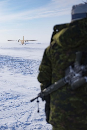 A Canadian solider watches as a Canadian Airforce CC-138 Twin Otter take off during Operation Nunalivut near Resolute,NU on Saturday Apr 9, 2016. Operation Nunalivut featured over 200 personal from every branch of the Canadian Forces and military partners from the United States and Denmark. Gavin John/Special to PostMedia Network
