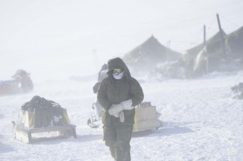 A Canadian solider walks through camp in heavy winds during Operation Nunalivut near Resolute,NU on Saturday Apr 9, 2016. Operation Nunalivut featured over 200 personal from every branch of the Canadian Forces and military partners from the United States and Denmark. Gavin John/Special to PostMedia Network