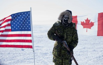 A Canadian solider stands in front of American and Canadian flags during Operation Nunalivut near Resolute,NU on Saturday Apr 9, 2016. Operation Nunalivut featured over 200 personal from every branch of the Canadian Forces and military partners from the United States and Denmark. Gavin John/Special to PostMedia Network