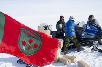 "Members of the Canadian Rangers work on a snowmobile during Operation Nunalivut near Resolute,NU on Saturday Apr 9, 2016. The Rangers are almost entirely made up of indigenous people of the north and are the ""eyes and ears"" of the Canadian Forces in the north. Gavin John/Special to PostMedia Network"