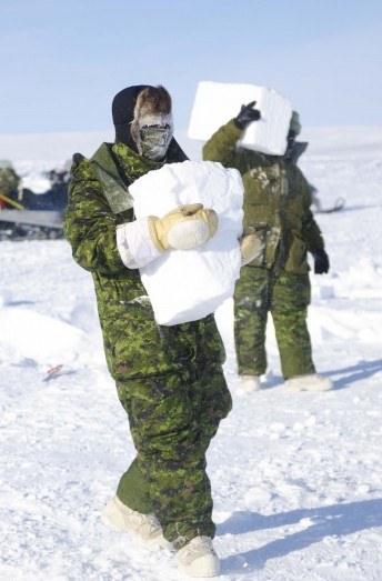 Canadian Forces soldiers cut snow for added protection to their tents against the elements during Operation Nunalivut near Resolute,NU on Saturday Apr 9, 2016. Operation Nunalivut featured over 200 personal from every branch of the Canadian Forces and military partners from the United States and Denmark. Gavin John/Special to PostMedia Network