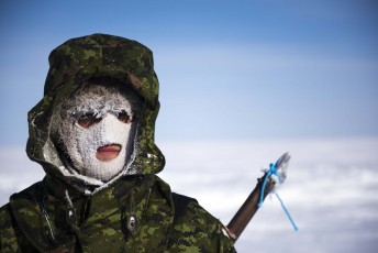 A Canadian Forces solider stands guard during Operation Nunalivut near Resolute,NU on Saturday Apr 9, 2016. Operation Nunalivut featured over 200 personal from every branch of the Canadian Forces and military partners from the United States and Denmark. Gavin John/Special to PostMedia Network