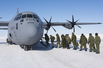 Canadian and American Forces load up on a C-130 Hercules aircraft during Operation Nunalivut near Resolute,NU on Sunday Apr 10, 2016. Operation Nunalivut featured over 200 personal from every branch of the Canadian Forces and military partners from the United States and Denmark. Gavin John/Special to PostMedia Network
