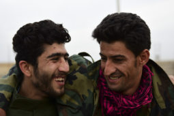 Two Peshmerga soldiers share a laugh between fighting in Bishaqa, Iraq on Thursday Nov 10, 2016. The town was liberated two days ago by Iraqi Peshmerga forces along with reports of Canadian Special Forces.  Gavin John