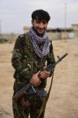 An Iraqi Peshmerga solider poses for a photo in Bishaqa, Iraq on Thursday Nov 10, 2016. The town was liberated two days ago by Iraqi Peshmerga forces along with reports of Canadian Special Forces.  Gavin John